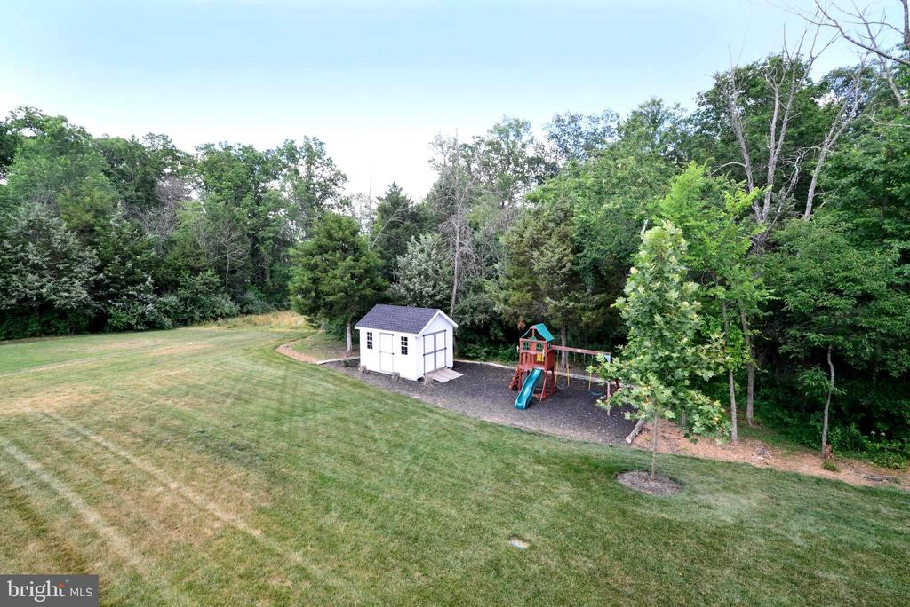 Amish Shed and Playset in yard - 24890 DAHLIA MANOR PL, ALDIE