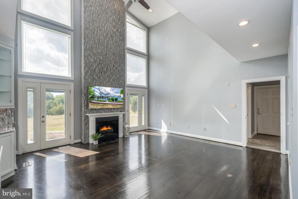 Family Room With Volume Ceilings and Fireplace - 22669 WATSON RD, LEESBURG