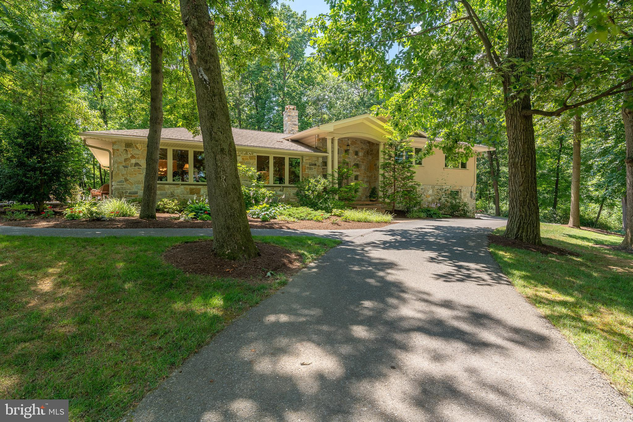 Privacy abounds on this 1.7 acre lot