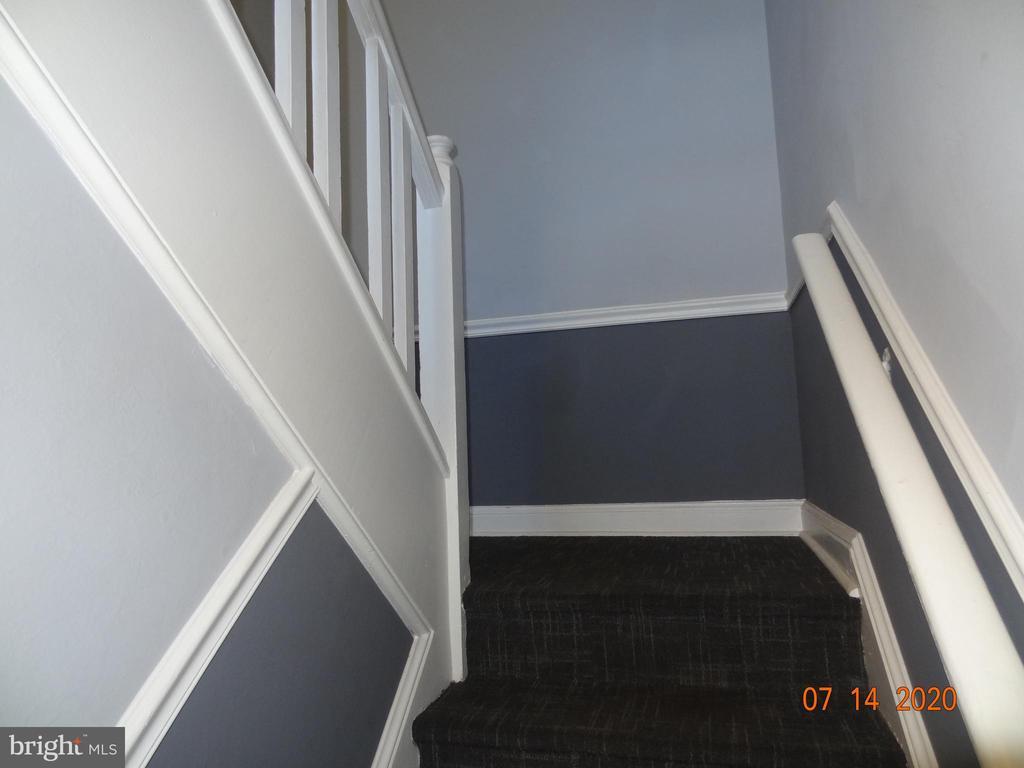 Stairway up to 2nd Floor Top Floor Condo - 2411 ARLINGTON BLVD #201, ARLINGTON