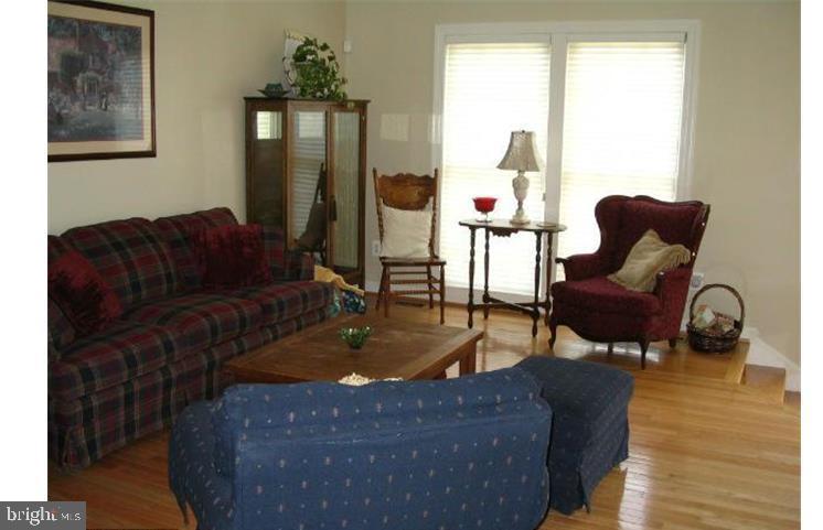 MMK Realty LLC Living room with Hardwood floors - 6659 DEBRA LU WAY, SPRINGFIELD
