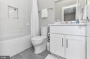 Sleek contemporary bathroom with Tile + Quartz - 603 SLADE CT, ALEXANDRIA