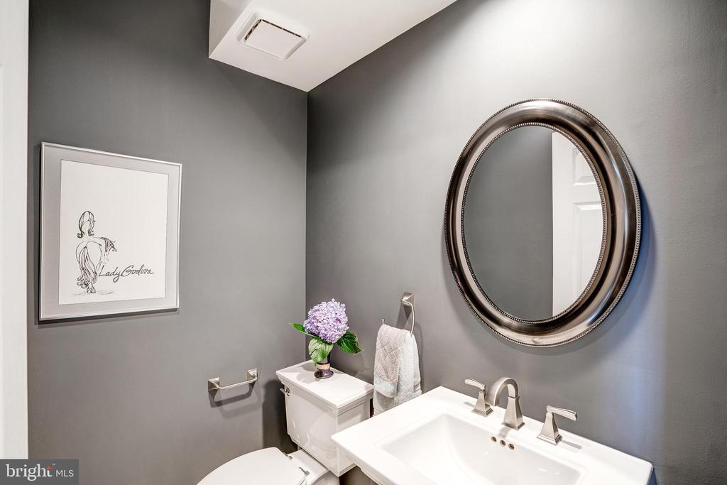 Renovated marble first floor powder room - 9318 LUDGATE DR, ALEXANDRIA