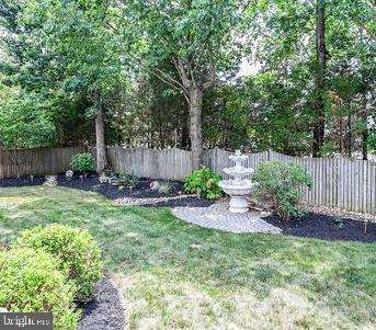 Backyard with fountain - 6420 GUARD MOUNT CT, CENTREVILLE
