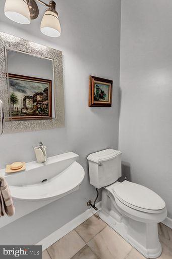 Powder room with marble floor and italian sink - 6420 GUARD MOUNT CT, CENTREVILLE