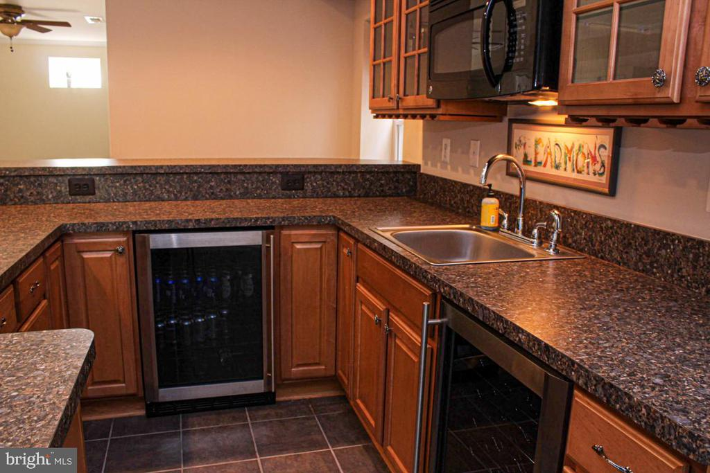 bar in lower level with wine cooler and fridge - 3220 LACROSSE CT, DUNKIRK