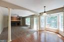 Family room with wood burning fireplace! - 15138 HOLLEYSIDE DR, DUMFRIES