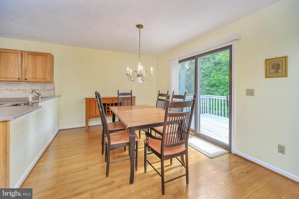 Dining Area with sliding glass doors to deck - 109 INDIAN HILLS RD, LOCUST GROVE
