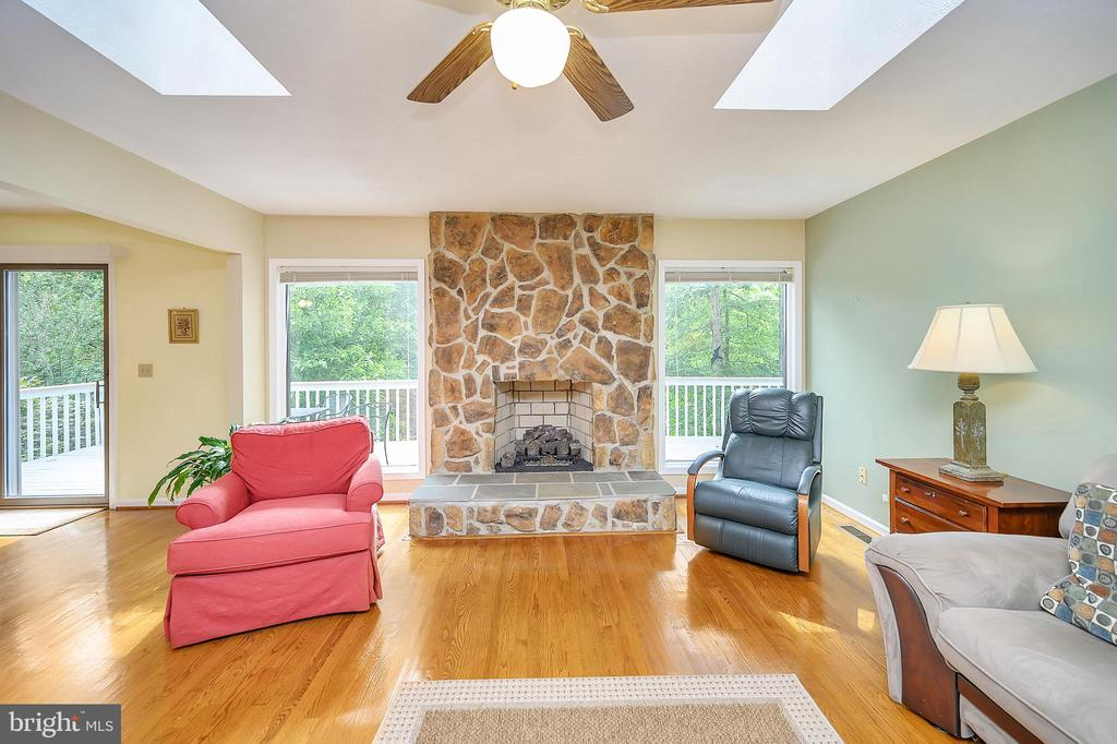 Look at that Fireplace surrounded by huge windows! - 109 INDIAN HILLS RD, LOCUST GROVE