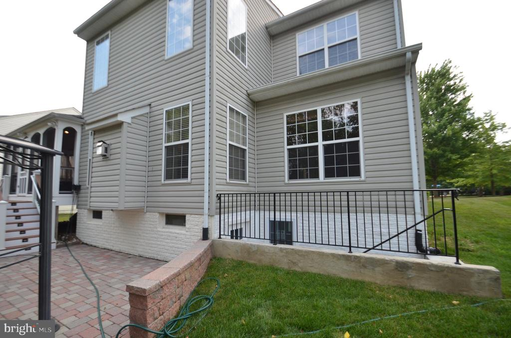 Back exterior with egress below office. - 358 SUGARLAND MEADOW DR, HERNDON