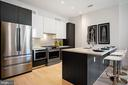 Open floor plan living, gourmet kitchen - 1745 N ST NW #208, WASHINGTON