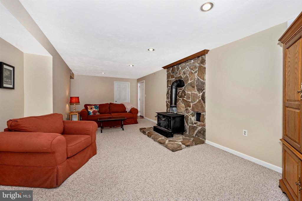 Lower level family room. Wood stove & stone hearth - 8707-A N PACIFIC CT, MIDDLETOWN