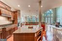 Gourmet kitchen with granite and island - 18382 FAIRWAY OAKS SQ, LEESBURG