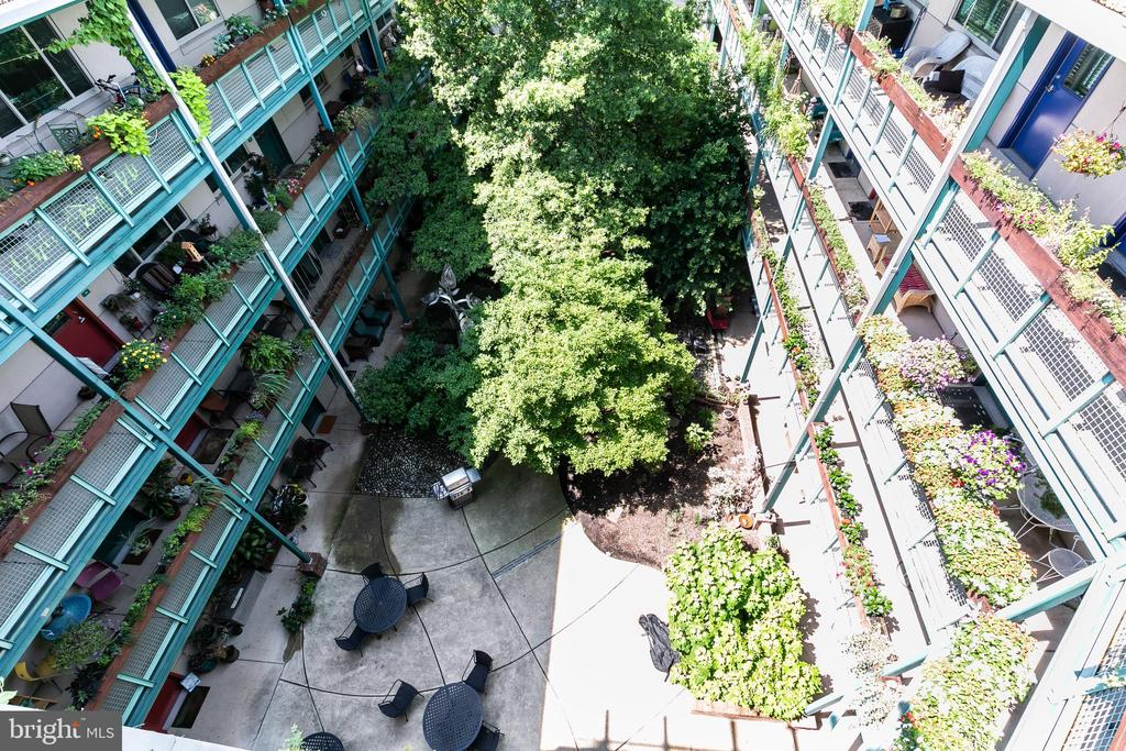 View of the courtyard from the roof deck. - 7981 EASTERN AVE #202, SILVER SPRING