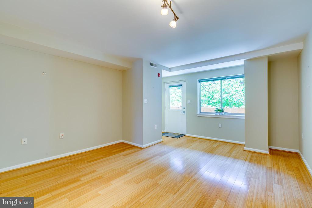 Windows in front provide nice light. - 7981 EASTERN AVE #202, SILVER SPRING