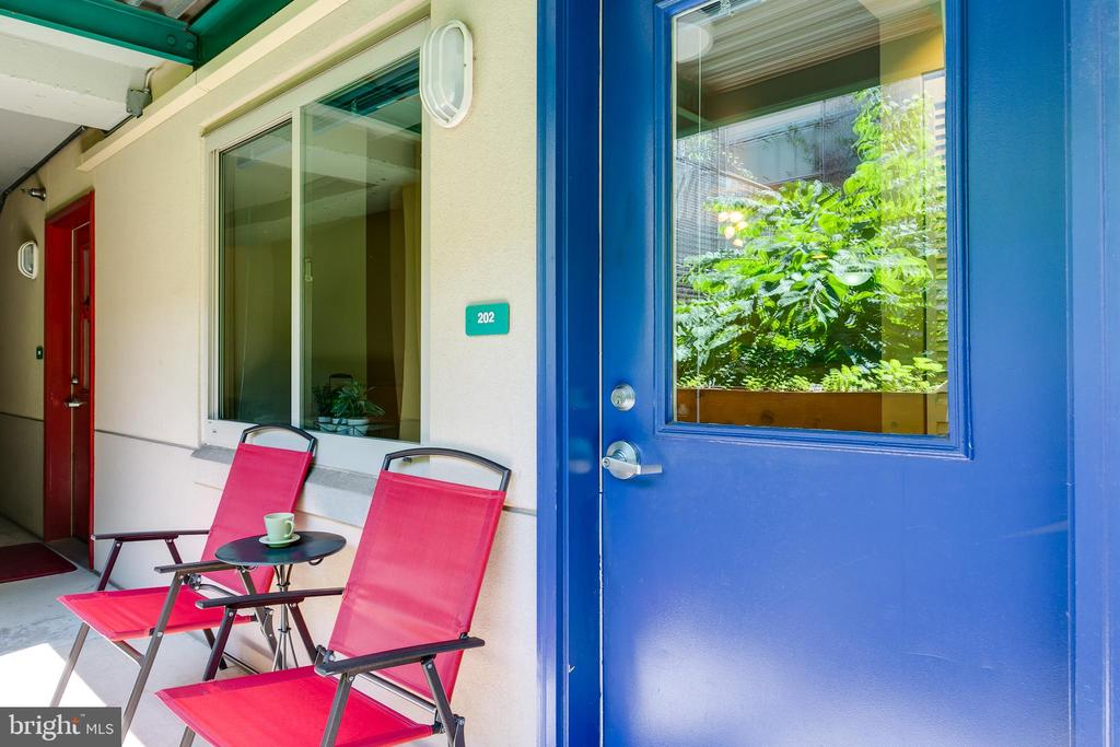 Enjoy coffee or a glass of wine outside your door. - 7981 EASTERN AVE #202, SILVER SPRING