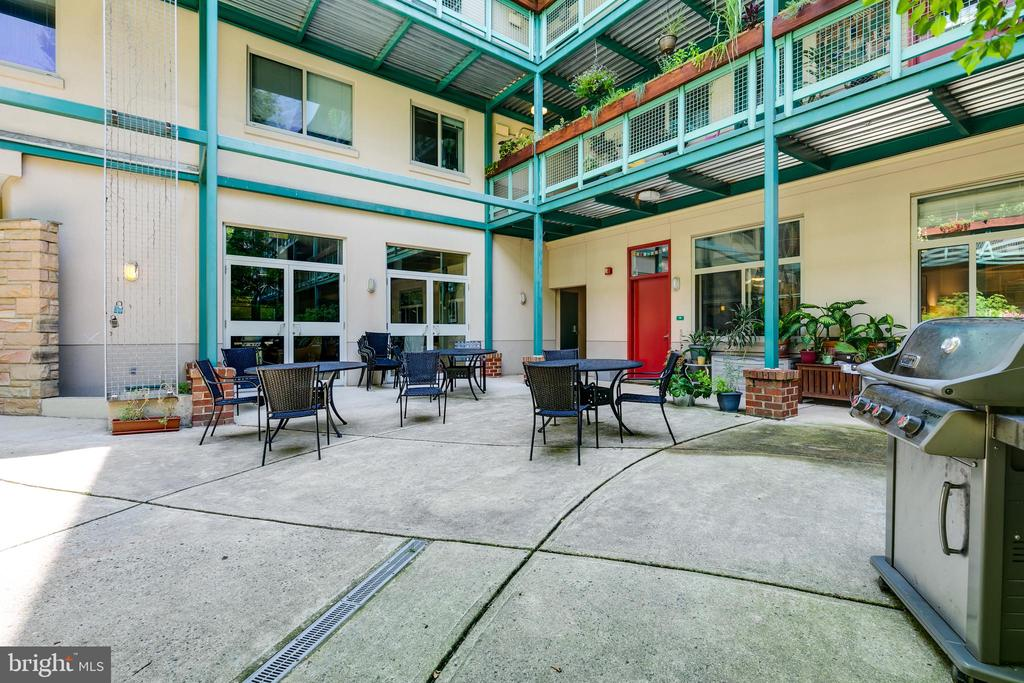 Common patio/grilling area. - 7981 EASTERN AVE #202, SILVER SPRING