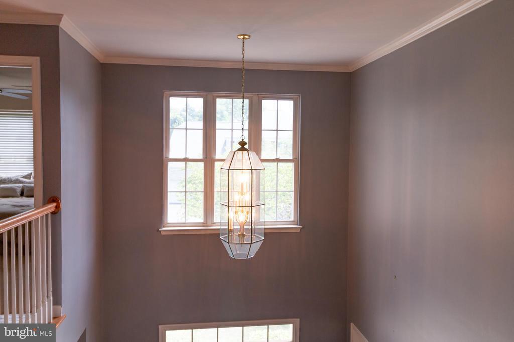 light in open foyer - 1302 WANETA CT, ODENTON