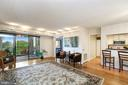 Living room opens to 2nd bedroom & kitchen - 5902 MOUNT EAGLE DR #609, ALEXANDRIA