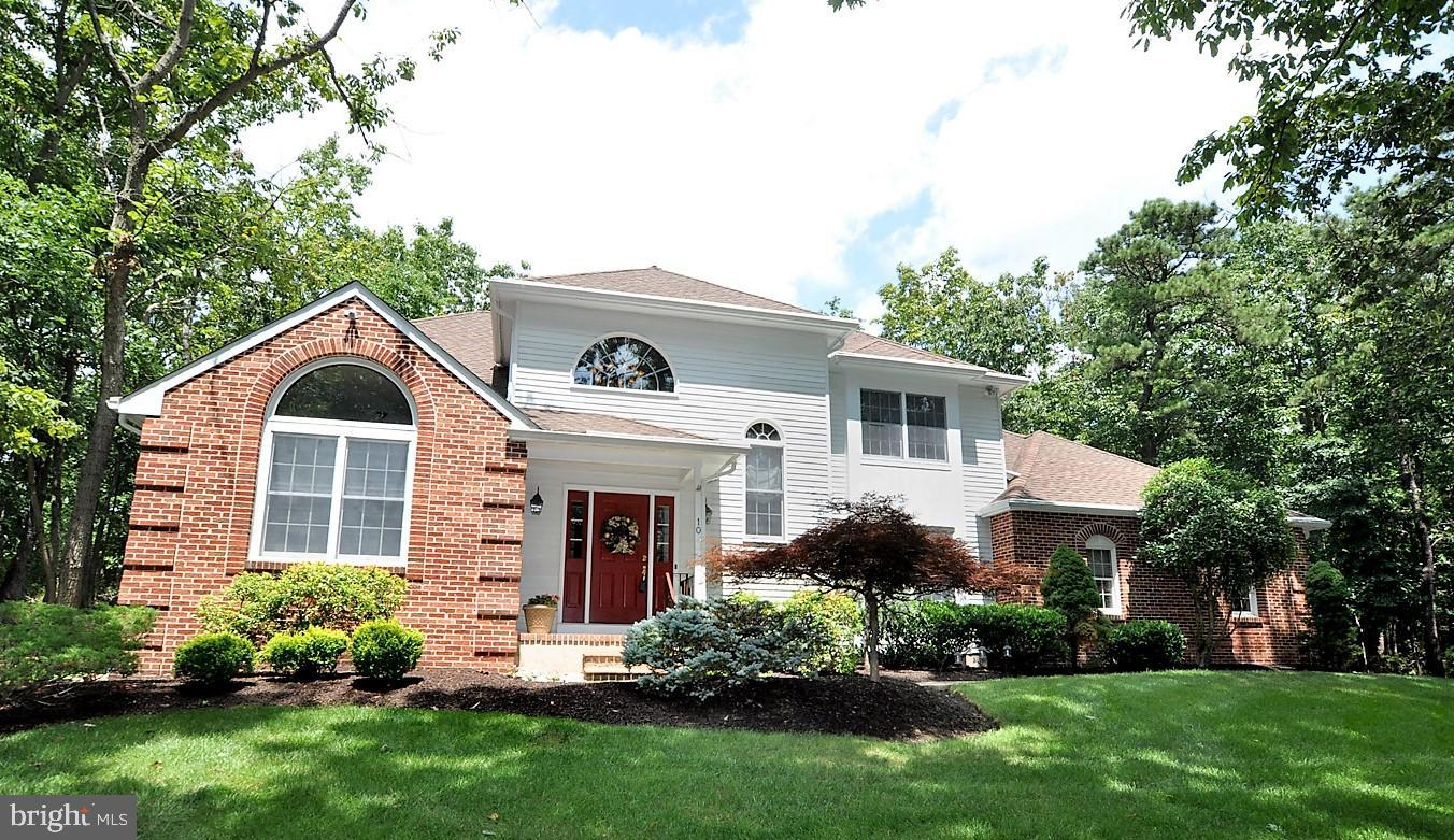 Situated on a 1.14 acre wooded lot