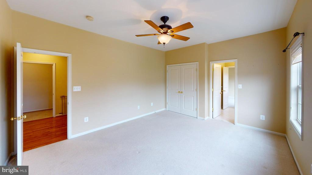 Master bedroom leading to two closets and bathroom - 1410 MACFREE CT, ODENTON