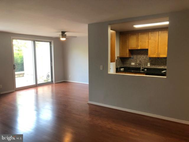 Dining area by sliding glass doors. - 1900 LYTTONSVILLE RD #306, SILVER SPRING