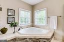 Relaxing soaking tub with tile detail - 904 LOCUST ST, HERNDON
