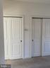 Master bedroom features a spacious closet - 1429 TRAFALGAR LN, FREDERICK