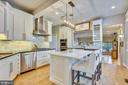 Pretty kitchen ,white wood cabinetry~ss appliances - 840 ELDEN ST, HERNDON