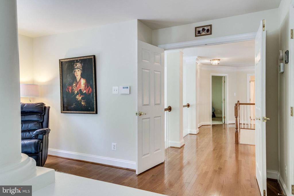 Hallway from Master Suite to 3 additional bedrooms - 3720 SPICEWOOD DR, ANNANDALE