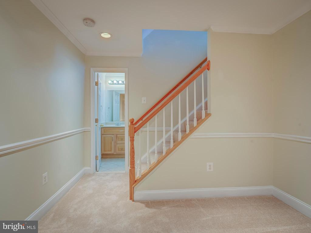 Lower Level Stairway to Recreation/Game Room - 103 ENGLISH CT SW, LEESBURG