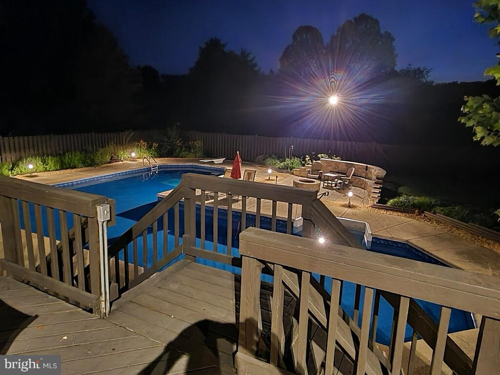 The deck off of the den leads down to pool. - 1676 LOUDOUN DR, HAYMARKET