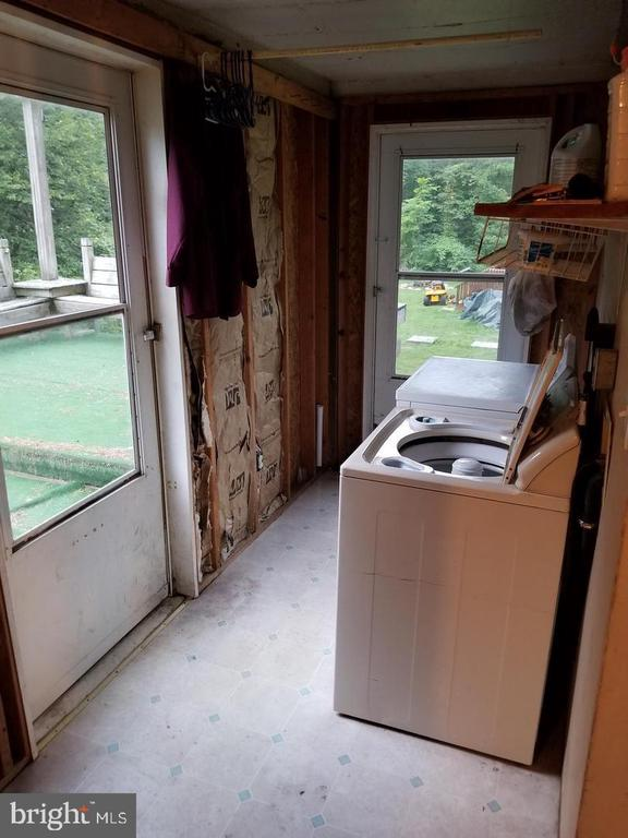 Laundry off the kitchen leading to deck. - 13407 CATOCTIN FURNACE RD, THURMONT
