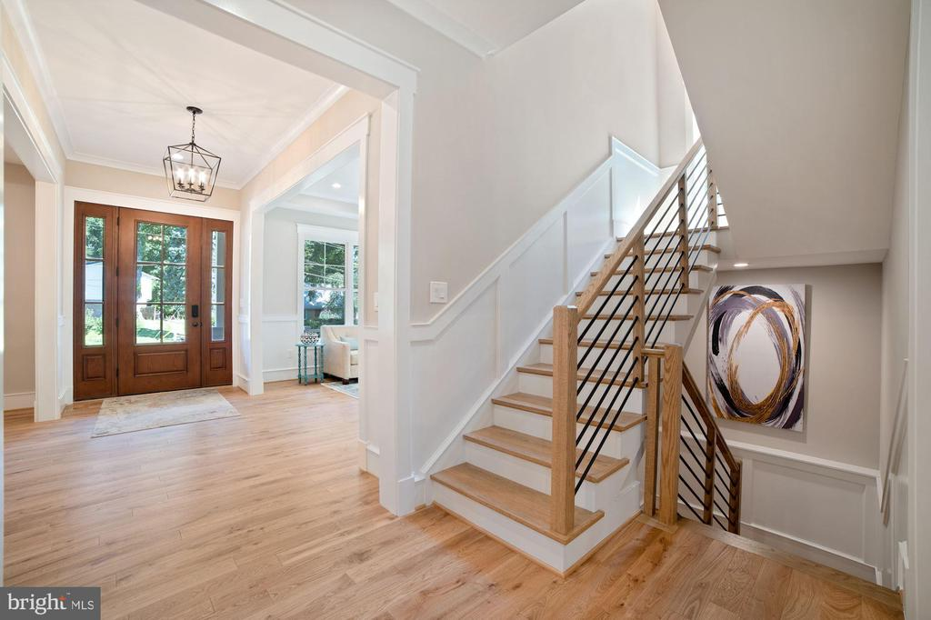 Inviting Custom Wood Stairs with black rail - 5631 SOUTHAMPTON DR, SPRINGFIELD