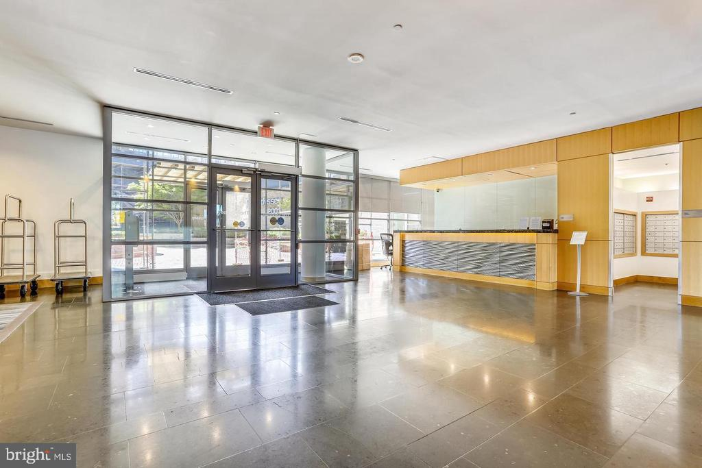 Chic lobby entrance with concierge desk - 2001 15TH ST N #203, ARLINGTON
