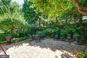 An enormous green garden, filled with perennials - 317 S SAINT ASAPH ST, ALEXANDRIA