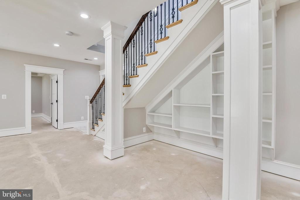 Under stairway you have a built in shelving - 14612 BRISTOW RD, MANASSAS