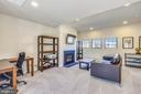 Top floor entertaining area with gas fireplace - 23410 ADAGIO TER, BRAMBLETON