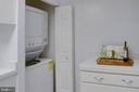 In-unit stacked washer and dryer. - 9802 KINGSBRIDGE DR #001, FAIRFAX