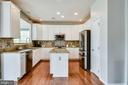 Kitchen Opens to Large Sun Room - 25973 STINGER DR, CHANTILLY