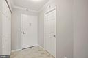 Entrance to unit w/ coat closet on left - 1600 N OAK ST #1716, ARLINGTON
