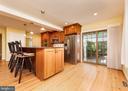 Open Kitchen to Patio - 10200 RED LION TAVERN CT, ELLICOTT CITY