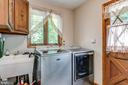 Laundry Room with closet, cabinets, utility sink - 1676 LOUDOUN DR, HAYMARKET