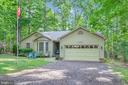 Landscaped to offer a front lawn & bed plants - 111 SILVER SPRING DR, LOCUST GROVE