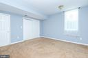 Basement bedroom with two closets and exit window - 6033 SUMNER RD, ALEXANDRIA