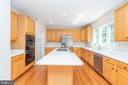 Kitchen has loads of cabinets and a walk-in pantry - 6033 SUMNER RD, ALEXANDRIA