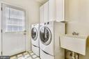 Mud room-laundry room has service door to the deck - 20405 EPWORTH CT, GAITHERSBURG