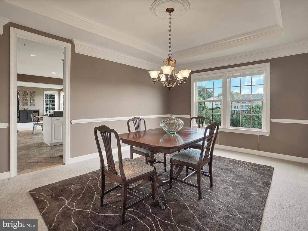 Dining room features chair rail. - 9509 TOTTENHAM CIR, FREDERICK