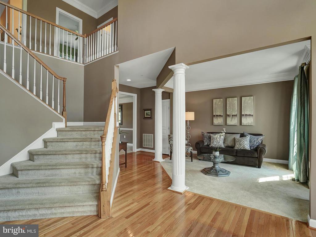 Foyer with gleaming hardwood floors. - 9509 TOTTENHAM CIR, FREDERICK
