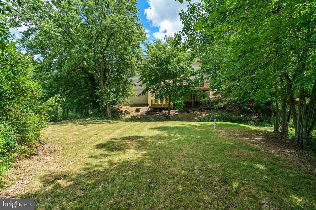 view of lawn and rear of home - 7304 BACKLICK RD, SPRINGFIELD